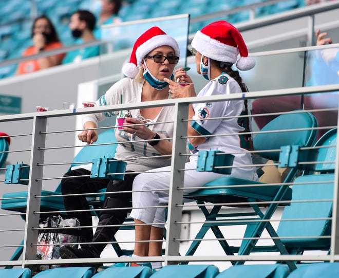 It's never too early to get your Santa Claus on as these two Dolphins fans at last Sunday's game at Hard Rock Stadium can attest.