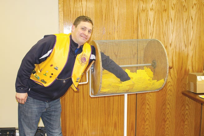 Pratt Lions Club President Andy Lee draws raffle winners during the club's annual fundraiser. The grand prize winner this year was Shelli Allen, Peoples Bank, who won a side of beef donated by Pratt Feeders, Xtra Factors and T&W Meats.