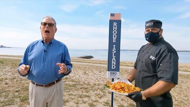 In this image from video, Rhode Island Democratic Party Chairman and state Rep. Joseph McNamara speaks during the state roll-call vote on the second night of the Democratic National Convention. At right is John Bordieri, executive chef at Iggy's Boardwalk on Oakland Beach in Warwick, with a big order of calamari.