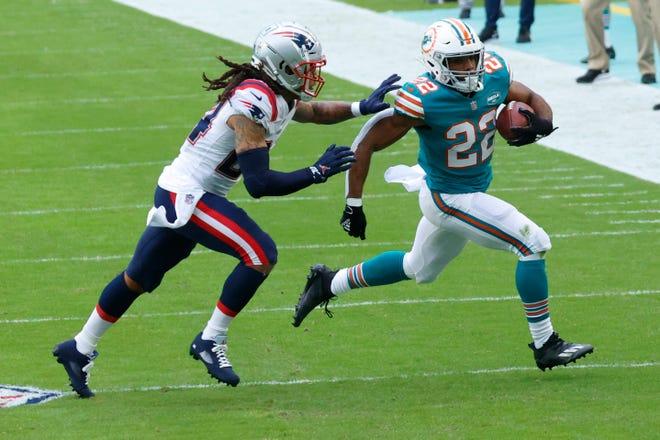New England Patriots cornerback Stephon Gilmore (24) runs after Miami Dolphins running back Matt Breida (22) during the first half of an NFL football game, Sunday, Dec. 20, 2020, in Miami Gardens, Fla.