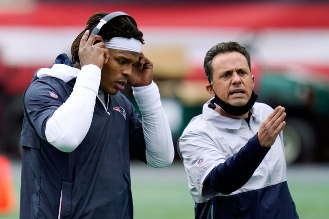Patriots quarterback Cam Newton, left, stands beside quarterback coach Jedd Fisch before an October game against the San Francisco 49ers in Foxboro. The University of Arizona is reportedly hiring Fisch as its head coach.