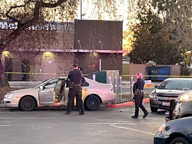 Stockton police officers investigate the scene at a parking lot at Hammer Lane and Don Avenue where a male victim died after a shooting at Sandman Park, also on Don Avenue. Two men were also wounded in the incident.