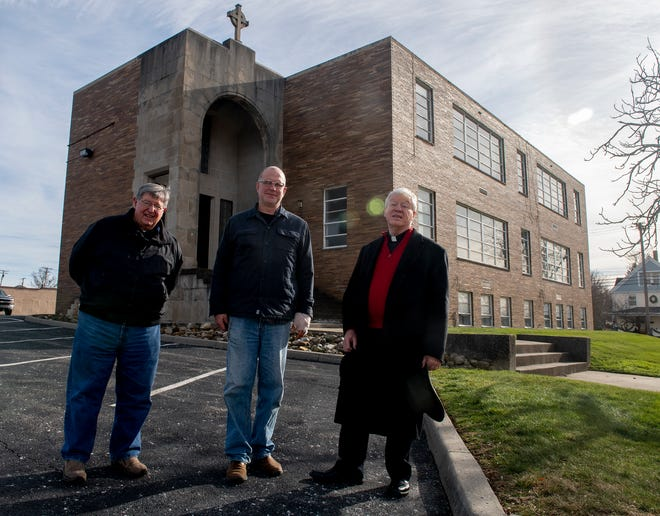 Immaculate Conception Parish in Ravenna has set up a capital campaign to renovate the former school building across the street from the church. From left are Chuck Calalesina, IC business manager; Eric Ruehr, deacon; and Father William Kraynak.