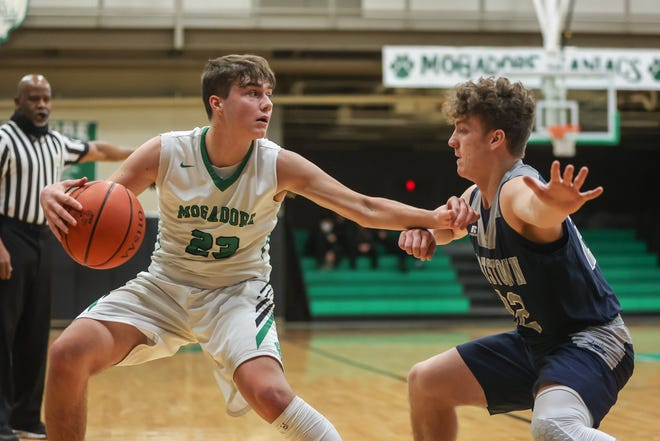 Mogadore senior Kody Jaber, left, with the ball while Rootstown's Brandan Nicholas defends Tuesday.