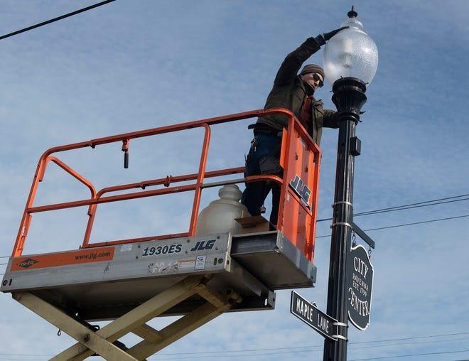 Rummel Electric crew operator installs new lights on South Prospect in Ravenna.