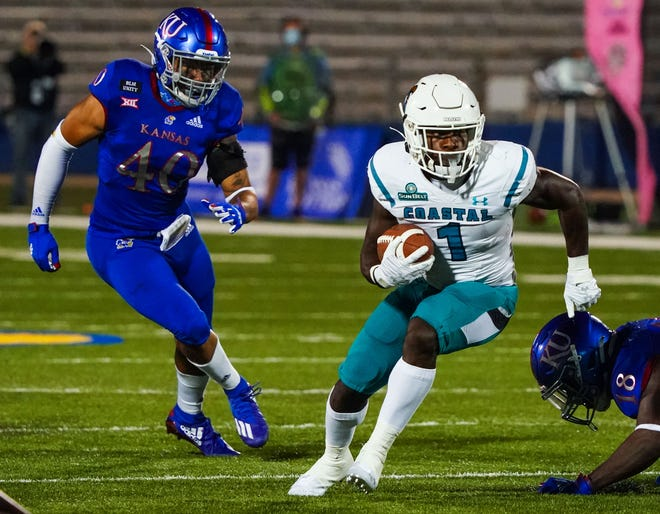 Running back CJ Marable (1) leads Coastal Carolina against Liberty in Saturday's Cure Bowl.