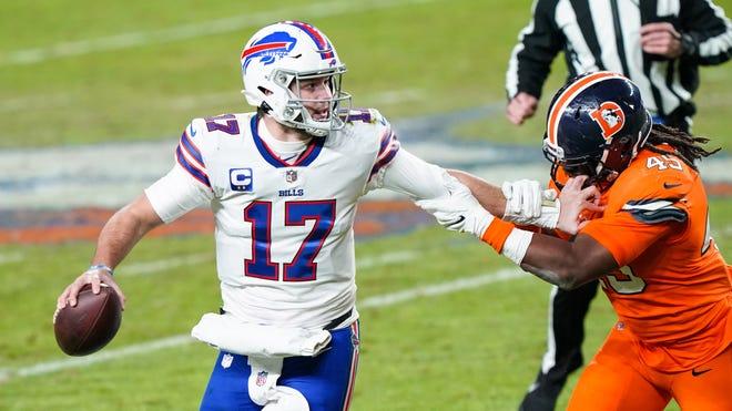 Quarterback Josh Allen (17) leads the Buffalo Bills against the New England Patriots on Monday night.