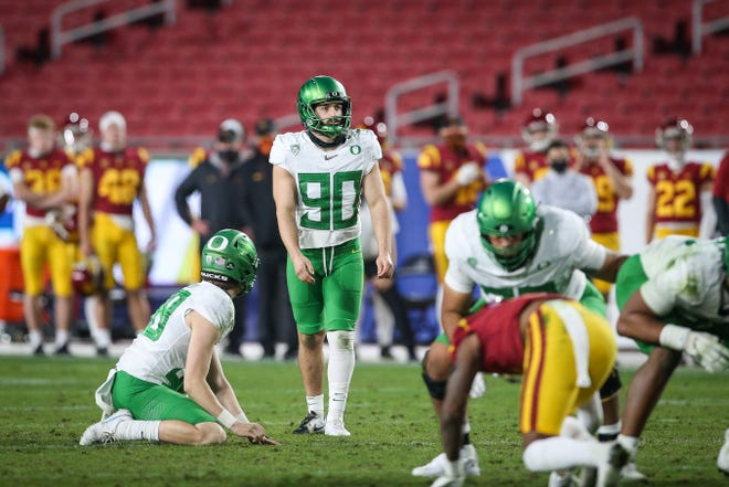 Oregon placekicker Henry Katleman lines up for a 40-yard field during the Ducks' 31-24 victory over the USC Trojans in the Pac-12 championship game at the Los Angeles Memorial Coliseum.