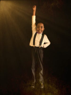 """Emmanuel Ross,a student at Canton Montessori, poses during a classroom lesson inspired by the musical """"Newsies."""""""