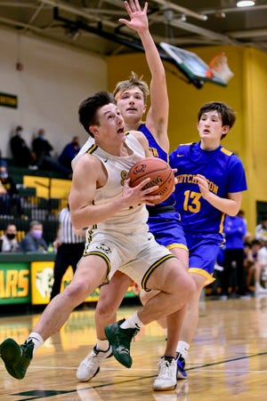 Salina South's Devon Junghans (10) goes up for a shot while being defended by Hutchinson's Jake Huhs (2) during Tuesday's game at the South gym.