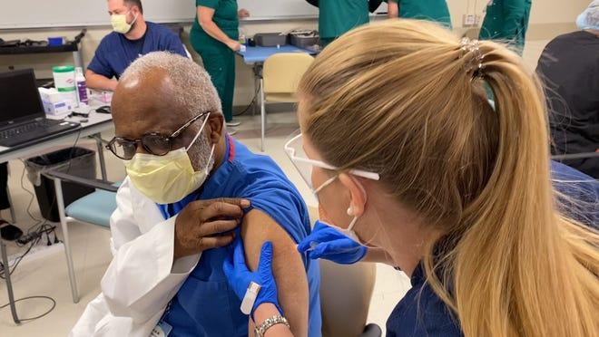 A Sarasota Memorial Hospital worker receives Moderna's COVID-19 vaccine recently.