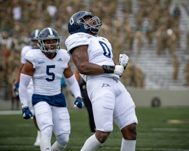 Georgia Southern senior defensive end Raymond Johnson III (0) celebrates a play with linebacker Benz Jose (5) against host Army on Nov. 21 in West Point, N.Y.