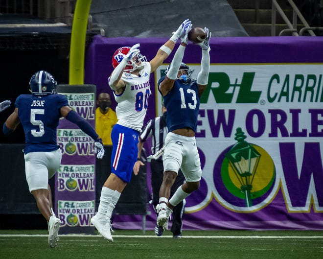 Georgia Southern cornerback Derrick Canteen (13) snares his sixth interception of the 2020 season during the 38-3 New Orleans Bowl game victory over Louisiana Tech on Dec. 23.