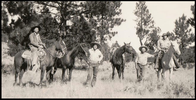 Gathering wild horses in 1934 in the Red Rock area near Macdoel, California. From left to right are Bob Dillman, Frank Bryan, Monroe Patterson and Cap Stacher. Bob, Frank and Cap were Scott Valley cowboys. Photographer unknown.