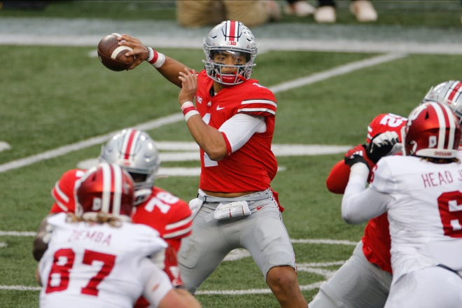 FILE - In this Nov. 21, 2020, file photo, Ohio State quarterback Justin Fields throws a pass against Indiana.
