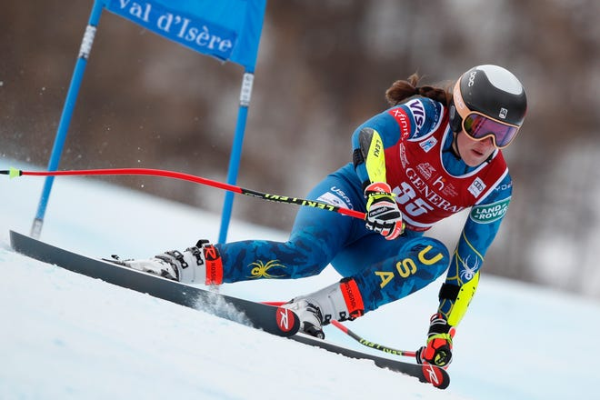 United States' Keely Cashman speeds down the course during an alpine ski women's World Cup Super G in Val d'Isere, France, Sunday, Dec. 20, 2020. (AP Photo/Gabriele Facciotti)