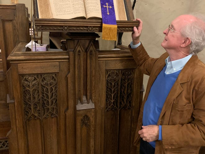 Charles Boney Jr., longtime church member at First Presbyterian, looks on at the Bible that was taken from the church during the Civil War and returned in 1928. The Bible missed the 1925 New Year's Eve fire that destroyed the church.