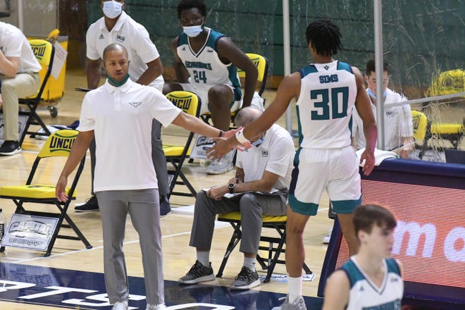 UNCW coach Takayo Siddle (left) and the Seahawks will have a wide-ranging schedule for the 2021-22 season as they introduce a bevy of new players for the season. [KEN BLEVINS/STARNEWS]
