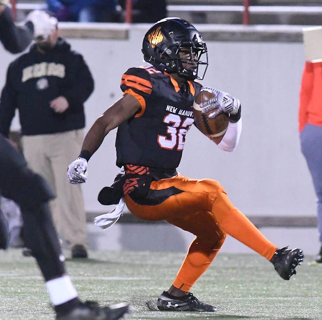New Hanover's #32 Razz Chandler picks up a few yards as New Hanover took on Gray's Creek at Legion Stadium Friday Nov. 29, 2019 in the third round of the NCHSAA 3AA Playoffs.
