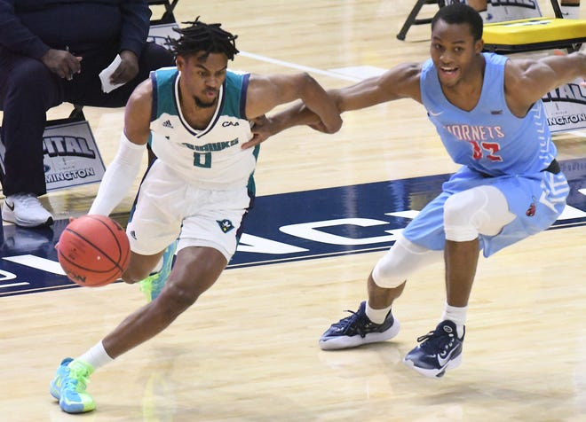 Ty Gadsden and UNCW, shown here during December's win against Delaware State, are off this weekend due to COVID-19 protocol within the program. The Seahawks could miss four total games if they are off for two weeks.