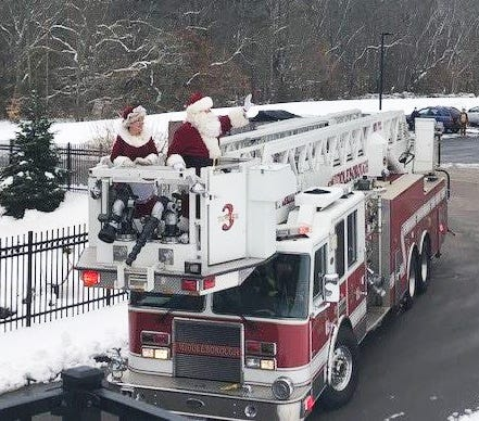 Mr. and Mrs. Claus made a special visit to the Shaw Home, waving to residents from a Middleborough Fire Department truck.
