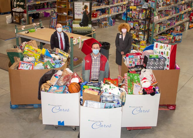 Brad Gifford, Josh Smith and Kimberly Coon pose with the collection of donated goods.