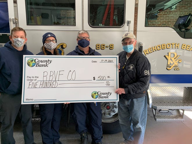 County Bank recently donated $500 to the Rehoboth Beach Volunteer Fire Co. From left: Chris Lessard, Terri Simpler, Mike Scheerer and Ted Doyle.