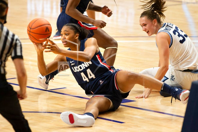 Connecticut forward Aubrey Griffin (44) gets the ball away from Villanova forward Sarah Mortensen (33) during the first half of an NCAA college basketball game Tuesday, Dec. 22, 2020, in Villanova, Pa.
