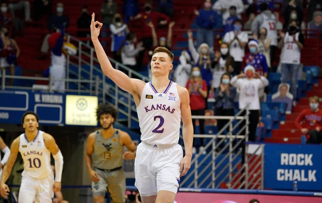 Kansas sophomore guard Christian Braun celebrates a made 3-pointer during the second half of Tuesday's game against West Virginia at Allen Fieldhouse. Braun hit six of the No. 3-ranked Jayhawks' 16 made 3s in his team's 79-65 victory.
