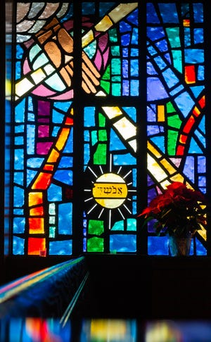 The Emma Thurber Memorial window from the south end within the sanctuary of Faith Lutheran Church, 1716 S.W. Gage Blvd., depicts the Apostles' Creed, showing the open, giving and creating hand of God by featuring parts of the heavens and earth. The window was the first given to the church provided through a provision in Thurber's will. In total there are seven memorial stained glass windows facing west with a large vertical stained glass window silhouetting a cross at the front of the sanctuary.