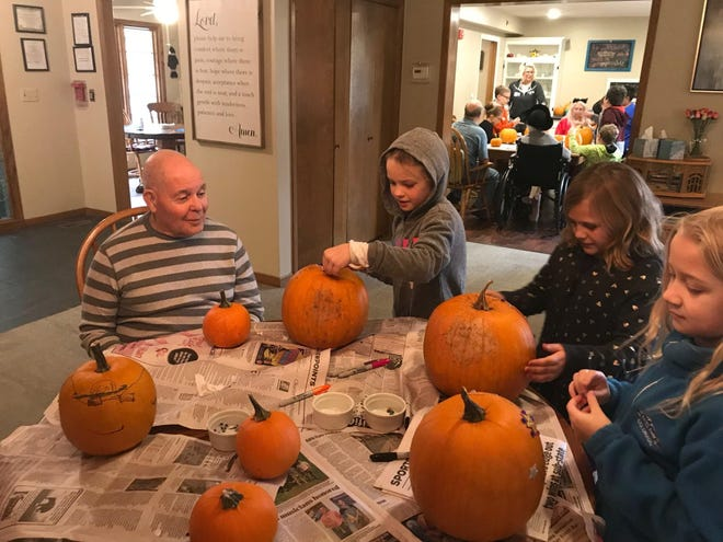 Elementary school students visit residents at ComfortCare Homes in Newton. ComfortCare is a home plus provider, which cares for a small number of residents, most of whom deal with dementia [2018 file photo/The Newton Kansan]