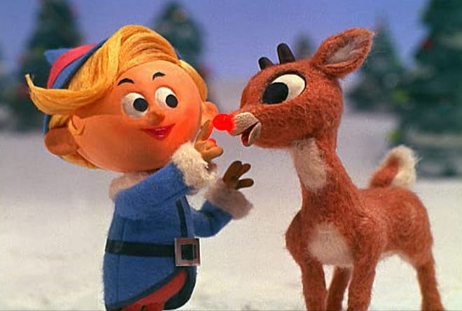 "Paul Soles, left, and Billie Mae Richards voice characters in ""Rudolph the Red-Nosed Reindeer."""