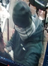 Fayetteville police obtained this surveillance photo of a suspect in a robbery at Sam's Food Mart on Gillespie Street.