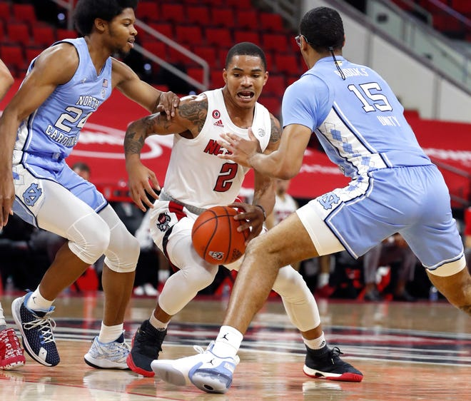 Freshman guard Shakeel Moore (2) came off the bench to score 17 points in NC State's 79-76 win against UNC on Tuesday night.