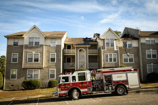 A fire truck sits outside a fire damaged apartment building at Stewarts Creek Apartments on Willowbrook Drive on Wednesday, Dec. 23, 2020. Red Cross workers are currently helping the families that were displaced. The cause of the fire is yet not known.