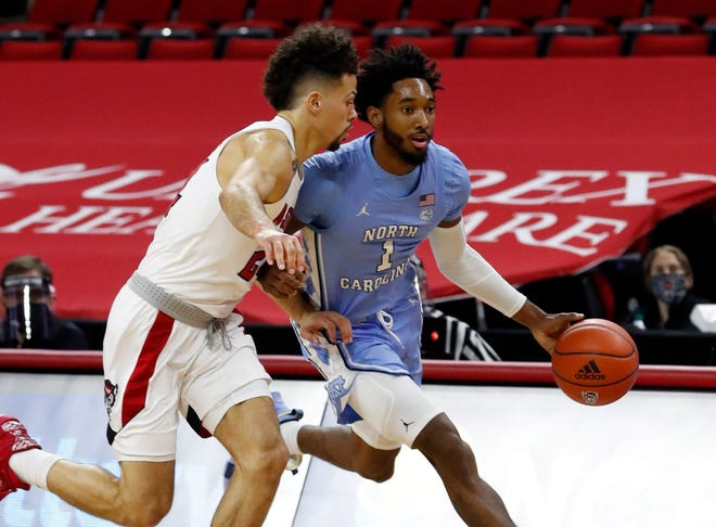 Devon Daniels, left, scored a game-high 21 points to help NC State earn its first win against UNC since 2018.