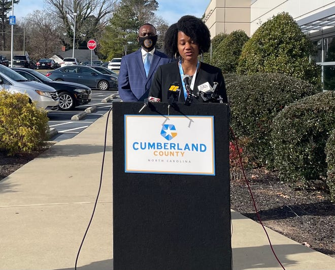 Dr. Jennifer Green speaks during a press conference Wednesday in Fayetteville. Behind her is Charles Evans, chairman of the Cumberland County Board of Commissioners.