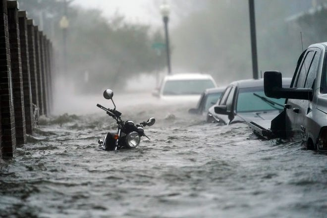 In this Sept. 16 photo, flood waters move on the street in Pensacola as Hurricane Sally made landfall near Gulf Shores.