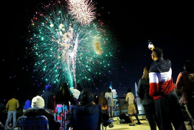 People watch fireworks at Depot Park in Gainesville on Dec. 31, 2019.