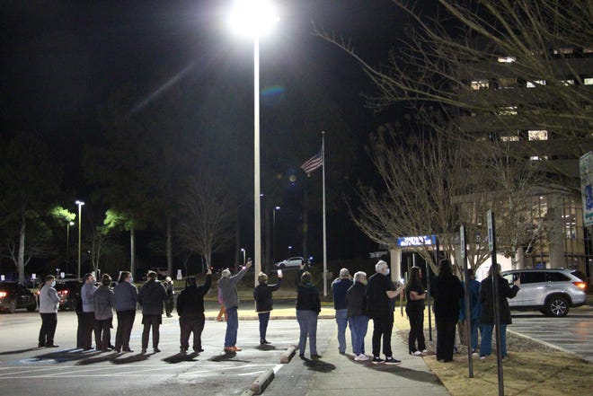 """People gather Monday at Gadsden Regional Medical Center for a vigil to to support health care workers and patients as the COVID-19 pandemic continues. Those attending were asked to use their cellphone cameras as """"candles."""""""