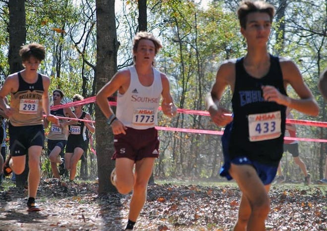 Southside's Will Anglea, middle, runs during the state championship meet at Oakville Indian Mounds Park in Moulton on Nov. 14.