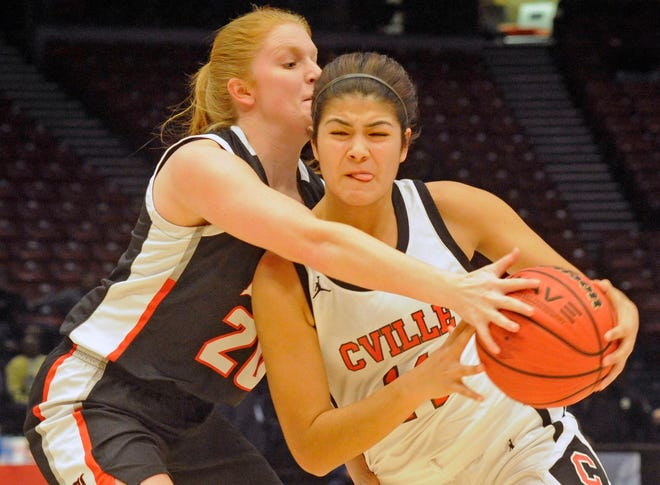 Collinsville's Brittany Rivera dribbles as G.W. Long's Katie Ann Mixon defends Monday, Feb. 24, 2020, during a Class 2A state semifinal matchup at the BJCC's Legacy Arena.