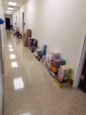 Children's Rehabilitation Service, a program of the Alabama Department of Rehabilitation Services, and a a few local businesses recently were able to ensure that some local families in need still will be able to have a very Merry Christmas.