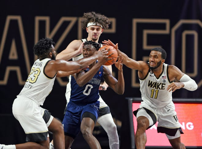 Wake Forest's Ian DuBose, right, Isaiah Wilkins, left, and Ismael Massoud, back, pressure Longwood's Leslie Nkereuwem during a game last month. DuBose is out indefinitely due to medical reasons, the Demon Deacons announced this week.