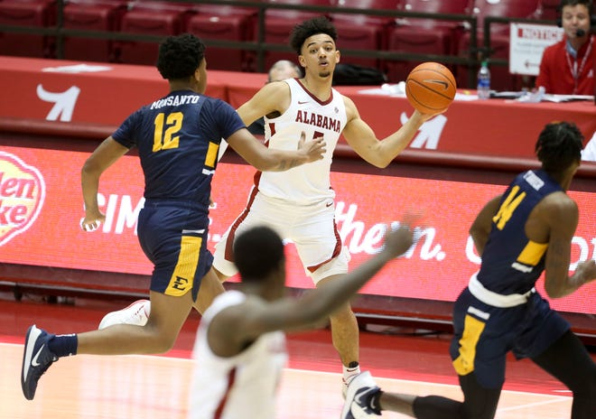 Alabama guard Jaden Shackelford (5) passes on a fast break to Alabama forward Juwan Gary (4) as they play against East Tennessee State in Coleman Coliseum Tuesday, Dec. 22, 2020. [Staff Photo/Gary Cosby Jr.]