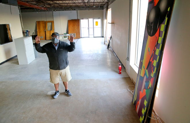 Bo Hicks shows the building that is being renovated to hold his expansion of Druid City Brewing Monday, Dec. 21, 2020. [Staff Photo/Gary Cosby Jr.]