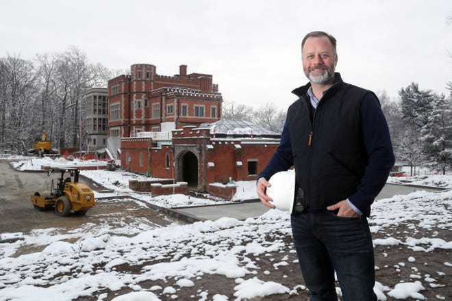 Mayor Ben Kessler is shown outside Jeffrey Mansion on Dec. 18 as construction crews continue working on the renovation and expansion project, which is one of the city's priorities for this year.