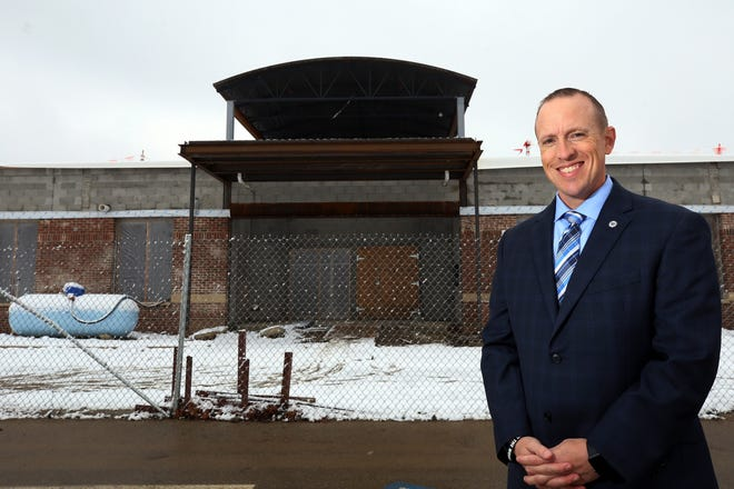 Worthington Superintendent Trent Bowers stands in front of Perry Middle School, which is expected to open for the 2021-22 school year.