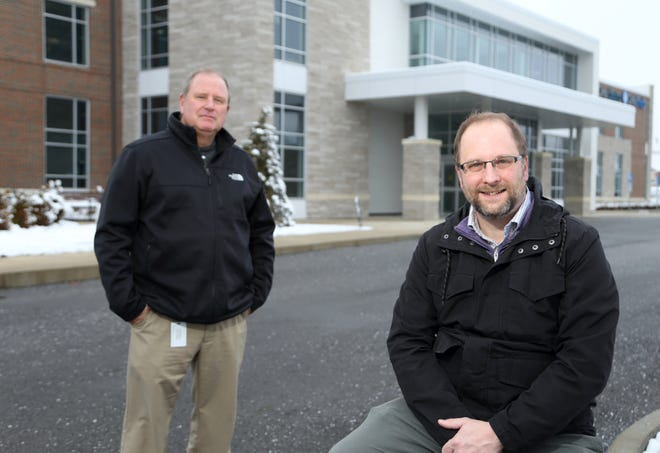 Dave Gulden (right), Pickerington economic development director, and City Manager Greg Butcher are seen Dec, 18 outside of the Ohio State University Wexner Medical Center-Outpatient Care Pickerington facility, still under construction, at 1025 Refugee Road. The center is expected to open in May.