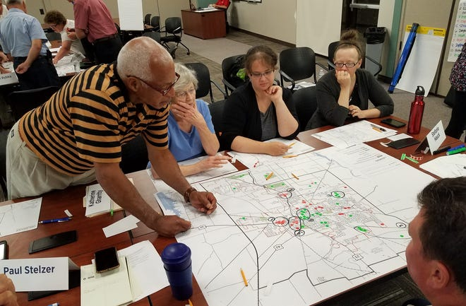 During a meeting before the pandemic, members of Delaware city's new comprehensive plan steering committee – Harry Hart, from left, Katherine Gharrity, Jacqueline Luzar and Stefanie Hauck – identify areas of focus for the plan that will be unveiled in 2021.